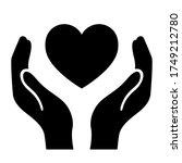 black heart on hands vector... | Shutterstock .eps vector #1749212780