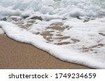 Sea Foam On Beach Sand  With...