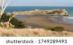 A Beach Between A Rocky Outcro...