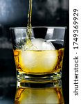 Small photo of Whiskey with a big round plait of ice