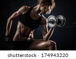 brutal athletic woman pumping... | Shutterstock . vector #174943220
