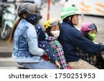 Young Vietnamese Family Of...