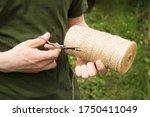 A Young Man Cuts Off A Stump...