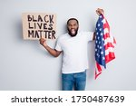 Small photo of Photo of screaming mad dark skin american protester hold placard usa flag standing city square against afro lawlessness revolution concept revolt strike isolated grey color background