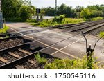 Empty railroad crossing in the...