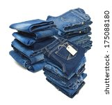 stack of blue jeans on white...