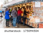 ZWOLLE, THE NETHERLANDS - FEBRUARY 1, 2014: Unidentified people buying groceries at the street market in Zwolle. In the Netherlands there are 18,000 merchants realising a 2.6 billion turn over. - stock photo