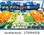 ZWOLLE, THE NETHERLANDS - FEBRUARY 1, 2014: Groceries on display at the street market in Zwolle. In the Netherlands there are 18,000 merchants realizing a 2.6 billion turn over. - stock photo