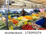 ZWOLLE, THE NETHERLANDS - FEBRUARY 1, 2014: Unidentified merchant selling groceries at the street market in Zwolle. In the Netherlands there are 18,000 merchants realizing a 2.6 billion turn over. - stock photo