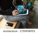 female hands scrolling tablet ...