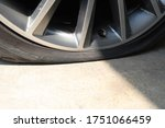 close up on car wheel flat tire | Shutterstock . vector #1751066459