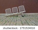 Row Of Damaged White Metal...