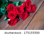 Stock photo red roses and a heart on wooden board valentines day background wedding day 175155500