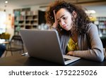 Small photo of Student woman finding it difficult at study and comprehend scool tasks