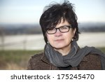 middle aged woman on a winter... | Shutterstock . vector #175245470