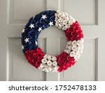 American Wreath On A White Door