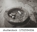Small photo of Rusty cigarette ashtray style. Ashtray is a container that is used as a dumping ground for cigarette ash and cigarette butts. Ashtrays are made of various materials such as wood, ceramics or glass.