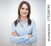 Small photo of Smiling business woman , crossed arms. Young model. Isolated.