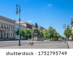 Small photo of Unter den Linden boulevard in the central Mitte district of Berlin with the equestrian statue of King Frederick II of Prussia and linden trees lining the pedestrian mall on the median