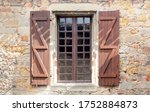 Window With Shutters On The...