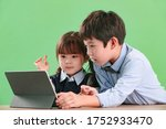 Small photo of Two PALS use tablet computers