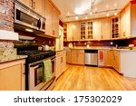 Stock photo impressive kitchen with burgundy backsplash brick wall wood storage combination and hardwood floor 175302029