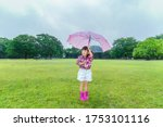 A Little Girl Standing In A...