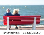 Senior Couple Sitting On Bench...