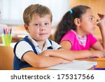 happy elementary students in... | Shutterstock . vector #175317566