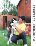young man and  his husky dog... | Shutterstock . vector #175325696