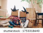 Couple With Cardboard Boxes On...