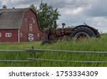 Old Tractor In A Field ...