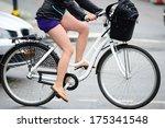 Bicyclist in rainy traffic - stock photo