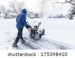 Man Clearing Snow With A Snow...