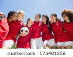 Happy Female Soccer Team With...