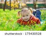 little girl lying on the grass... | Shutterstock . vector #175430528
