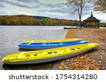 Colorful Kayaks Lying On The...