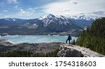 Hiker enjoying beautiful alpine vista in Canadian Rockies at Prairie View Trail, Kananaskis, Alberta, Canada - stock photo