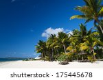tropical beach with boat and... | Shutterstock . vector #175445678