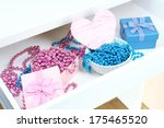 gift box and beads in open desk ... | Shutterstock . vector #175465520