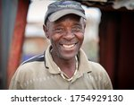 Small photo of Alexandra Township / South Africa - October 30, 2013: A man smiles for a picture in a Township of South Africa.