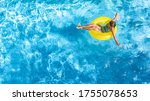 Active Young Girl In Swimming...