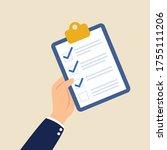 hand holding board checklist... | Shutterstock .eps vector #1755111206