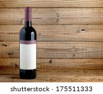 wine bottle on wooden background | Shutterstock . vector #175511333