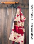 Small photo of Apron hanging on hook in kitchen with utensils - vintage tone effect
