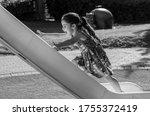 Little Girl Riding A Children\'...