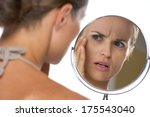 concerned young woman looking...   Shutterstock . vector #175543040