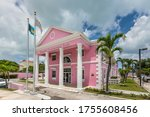 Small photo of Nassau, Bahamas - May 3, 2019: Pink building of Bahamas Development Bank in Nassau. The Bahamas Development Bank, a wholly owned government institution, was established in 1974 by an Act of Parliament
