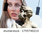 Rome Italy June 9, 2020. Moro Fountain Piazza Navona in Rome. Detail of the bust, on the huge background of contrasting billboards. - stock photo