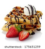 Belgium waffles with chocolate sauce, ice cream and strawberries isolated on white background